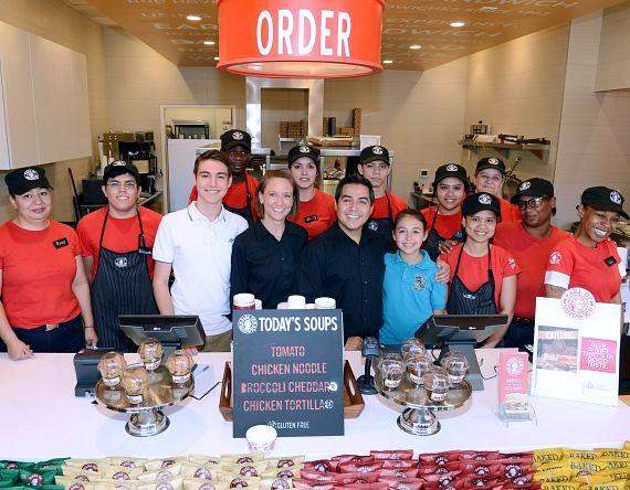 Owners Rey and Leigh Robledo and employees celebrate opening day at Earl of Sandwich in Downtown Summerlin Mall