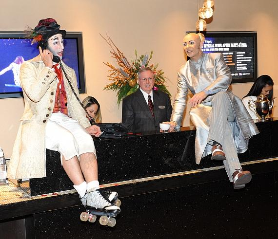 Characters from The Beatles LOVE check in visitors at the front desk