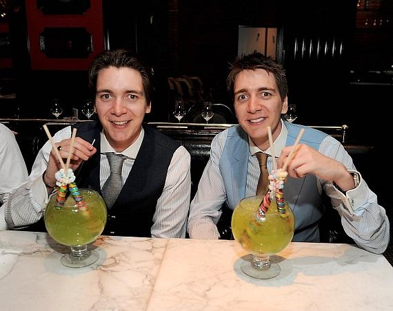 James and Oliver Phelps with Lollipop Passion goblet cocktails at Sugar Factory American Brasserie at Paris Las Vegas