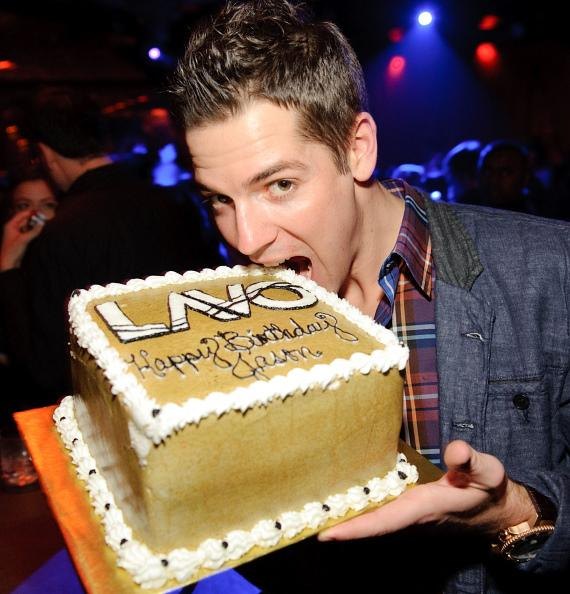 Jason Kennedy bites his birthday cake at LAVO