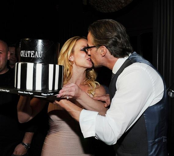 Jason Trawick shares a kiss with bride-to-be Britney Spears after she presents him with his birthday cake at Chateau Nightclub & Gardens