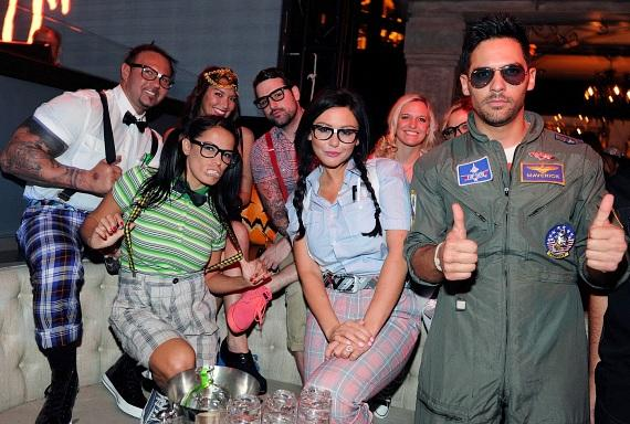 Jenni 'JWoww' Farley and her friends dress as nerds for Halloween and pose for a photo in the VIP booth at Chateau Nightclub