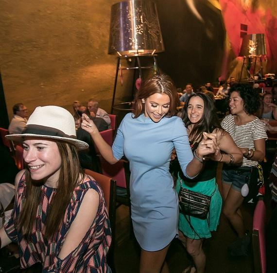 Jessa Hinton leading conga line at Tacos and Tequila