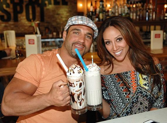 Joe and Melissa Gorga sharing milkshakes at Meatball Spot