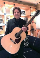 John Fogerty Presents Veterans Village Founder with Gibson Guitar Onstage at Wynn Las Vegas