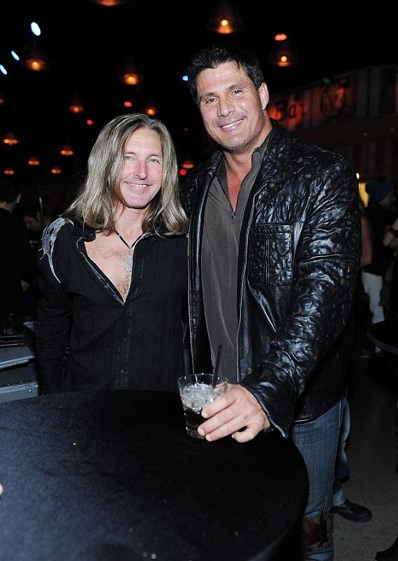 Jose Canseco and  Mark Matejka of Lynyrd Skynyrd at the grand opening of Lynyrd Skynyrd BBQ & Beer at Excalibur