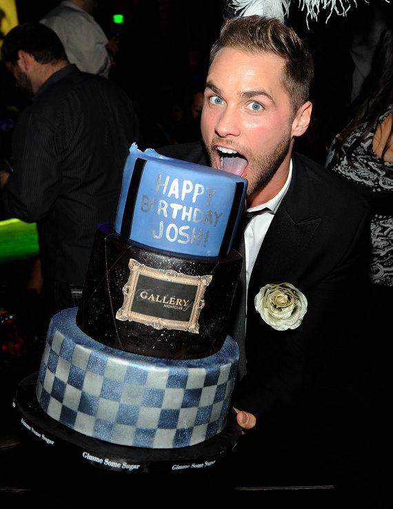 Josh Strickland takes a bite out of his birthday cake at Gallery Nightclub in Las Vegas