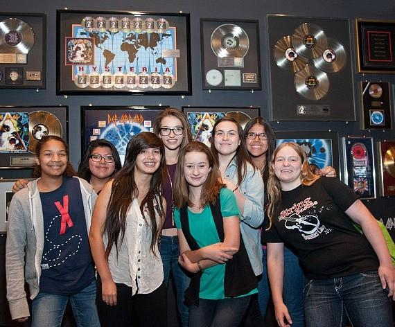 KO Knudson students pose at a Memorabilia Case at The Joint