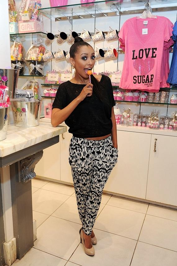 Kat Graham poses with a signature couture pop at Sugar Factory in Las Vegas