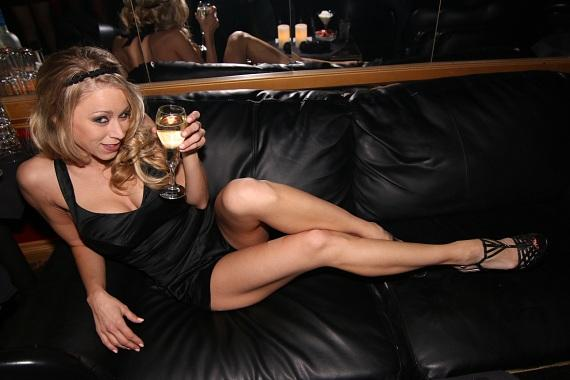 Katie Morgan sipping champagne