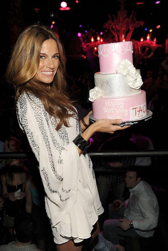Kelly Bensimon with birthday cake at TAO