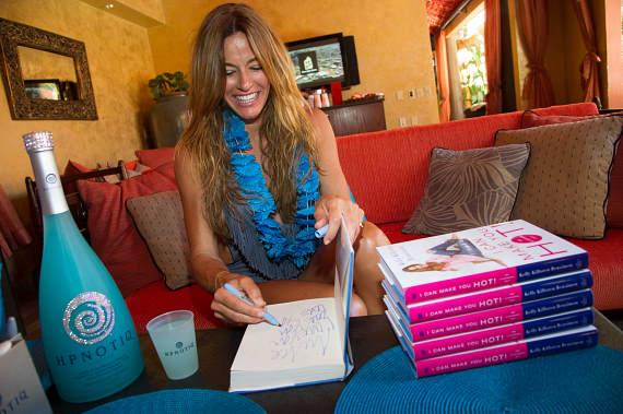 Kelly Bensimon signs her book at TAO Beach