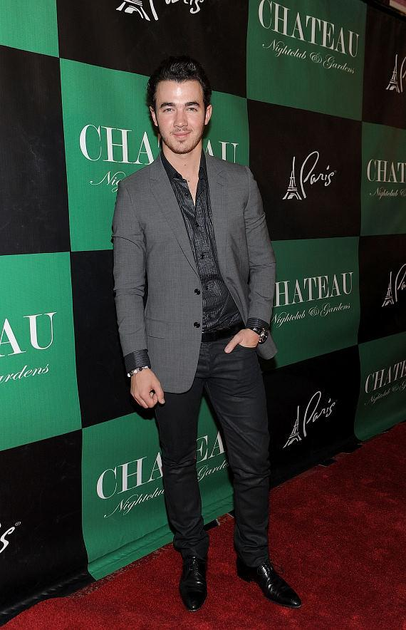 Kevin Jonas poses for pictures on the Chateau Red Carpet