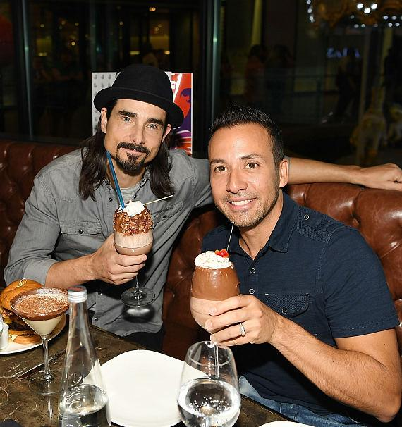 Kevin Richardson and Howie D. sip on chocolate based cocktail