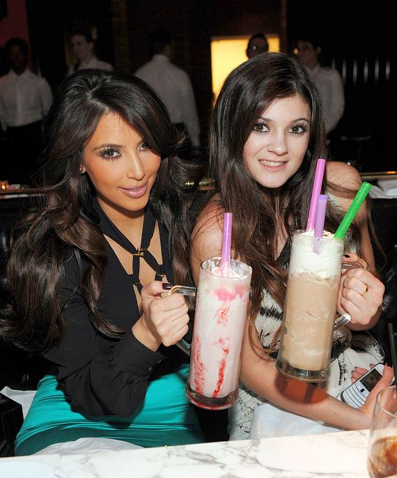 Kim Kardashian and Kylie Jenner with frozen hot chocolates at Sugar Factory American Brasserie
