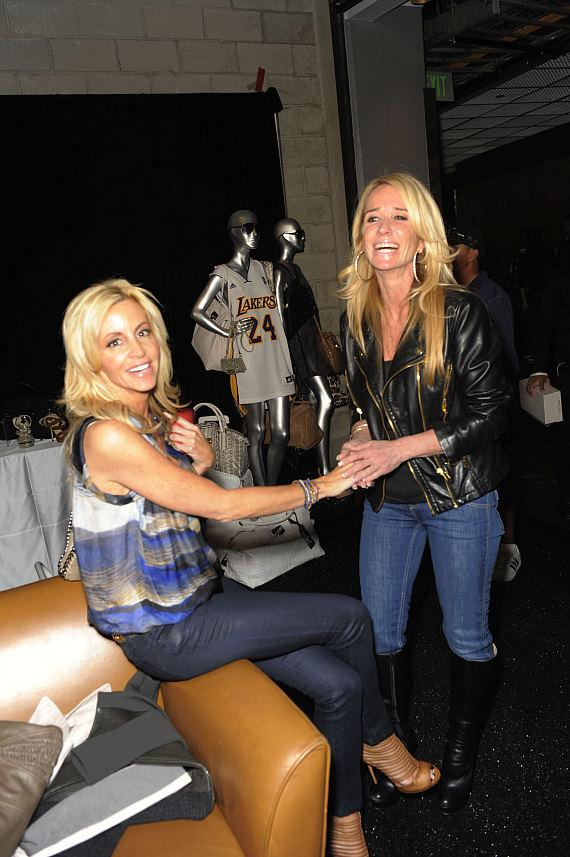 Kim Richards and Camille Grammer chat at the Shopping day event