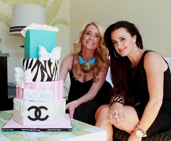 Kim and Kyle Richards with cake at Azure Luxury Pool