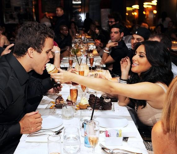 Kim Kardashian feeds Kris Humphries a cupcake at Sugar Factory at Paris Las Vegas