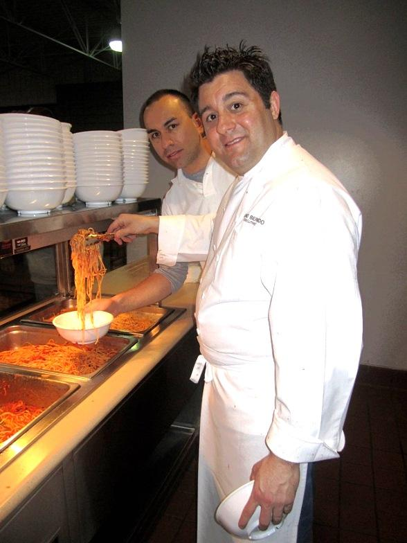 (L-R) Servando Daniels and Chef Geno Bernardo at Catholic Charities of Southern Nevada