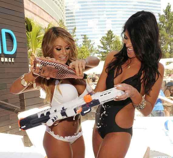 Aubrey O'Day and Krystan Bronson fill a watergun with Champagne at LIQUID Pool Lounge