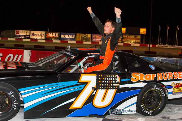 Chris Trickle (70) celebrates in victory lane after winning his first NASCAR Super Late Model feature during the NASCAR Whelen All-American Series Season Championship Night at The Bullring at Las Vegas Motor Speedway.