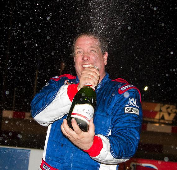Scott Gafforini (49) celebrates with champagne in victory lane after winning his fifth NASCAR Super Late Model season championship during the NASCAR Whelen All-American Series Season Championship Night at The Bullring at Las Vegas Motor Speedway