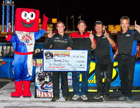 Jeremy Doss (75) poses in victory lane with family and crew after winning the NASCAR Super Late Model Open Comp 150 during the Fall Classic at The Bullring at Las Vegas Motor Speedway