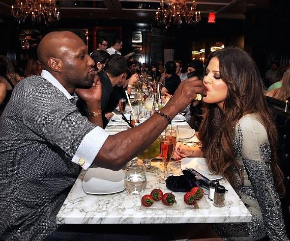 Lamar Odom feeds Khloé Kardashian Odom strawberries at Sugar Factory at Paris Las Vegas