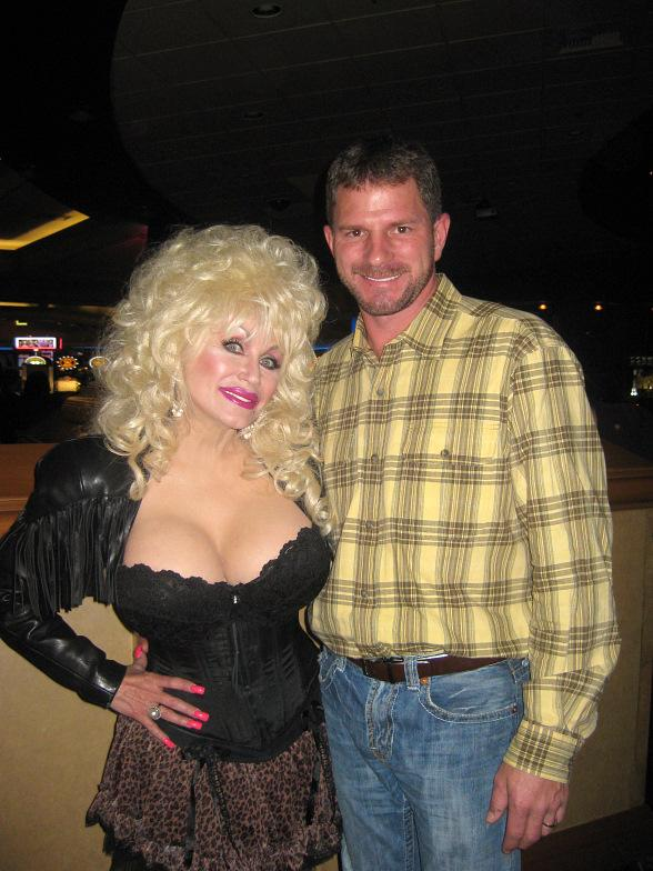 NASCAR® driver Kerry Earnhardt poses with the most authentic lookalike of the night, Sandy Anderson dressed up as Dolly Parton