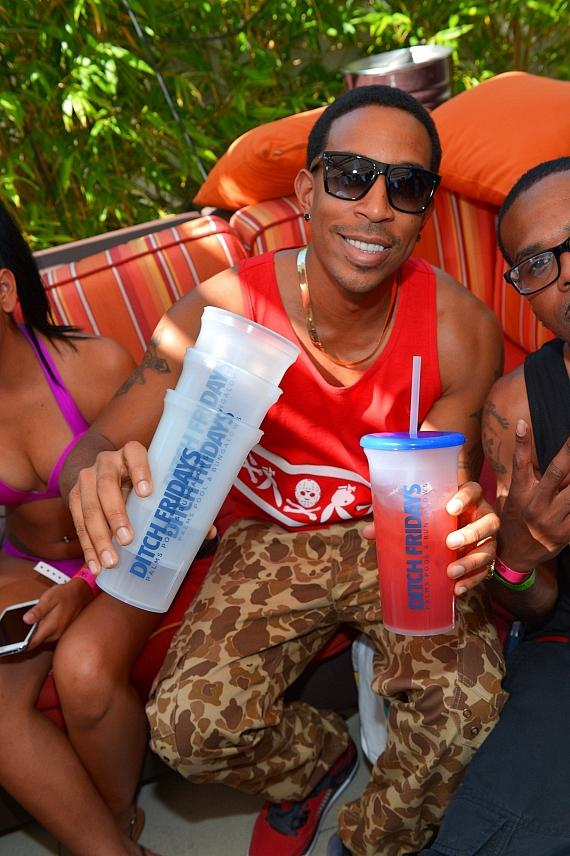 """Ludacris playfully shows off how much fun he's having at Palms Pool by grabbing a handful of """"Ditch Fridays"""" cups"""