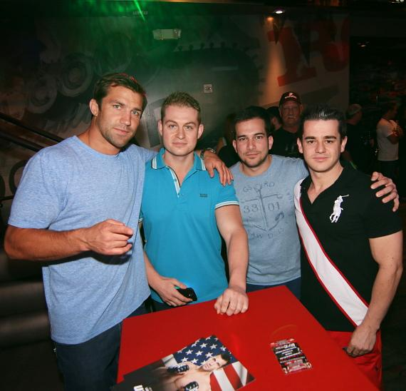 e Rockhold poses with aspiring fighters
