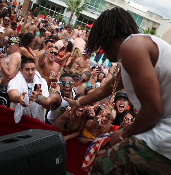 "Lupe Fiasco high fives ""Ditch Fridays"" partygoers."