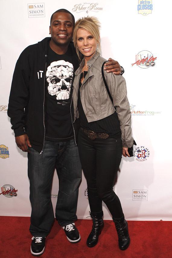Actor Mekhi Phifer poses with actress and tournament host Cheryl Hines