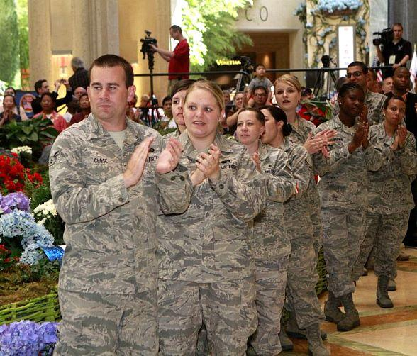Airmen welcome the wounded veterans in The Palazzo's red, white and blue decorated atrium and gardens