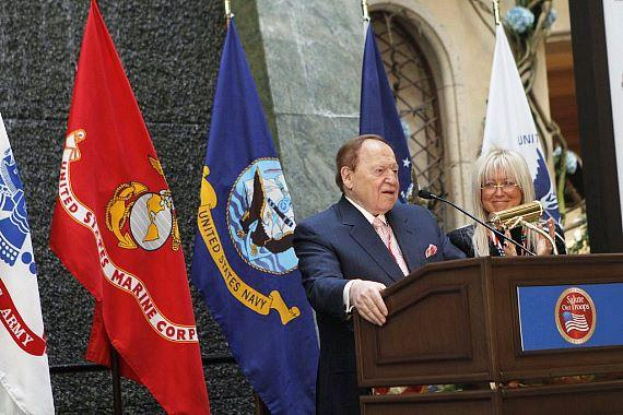 Dr. Miriam and Sheldon G. Adelson, chief executive officer and chairman of the board of Las Vegas Sands Corp. address the crowd