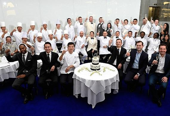 MR CHOW team toasts to one year (front row R-L: Sean McBurney, Cory Johnson, MR CHOW general manager, Patrice Rozat).