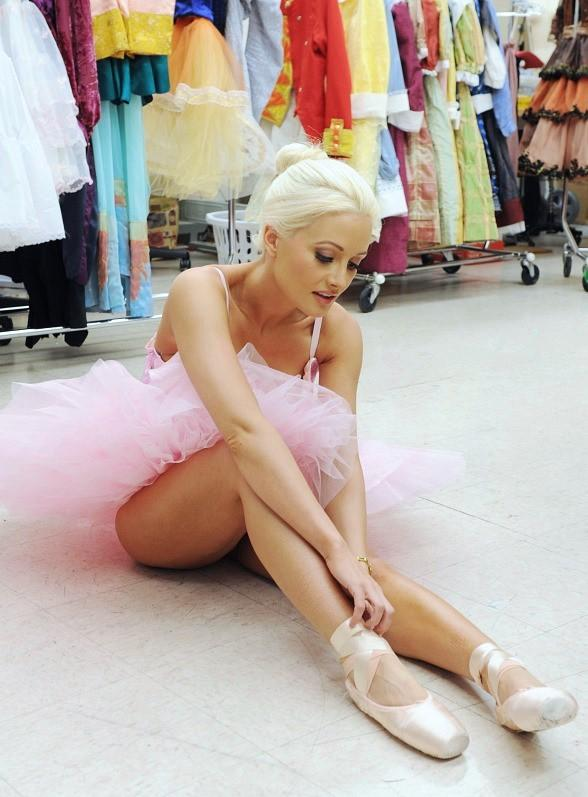 Holly Madison laces up pointe shoes