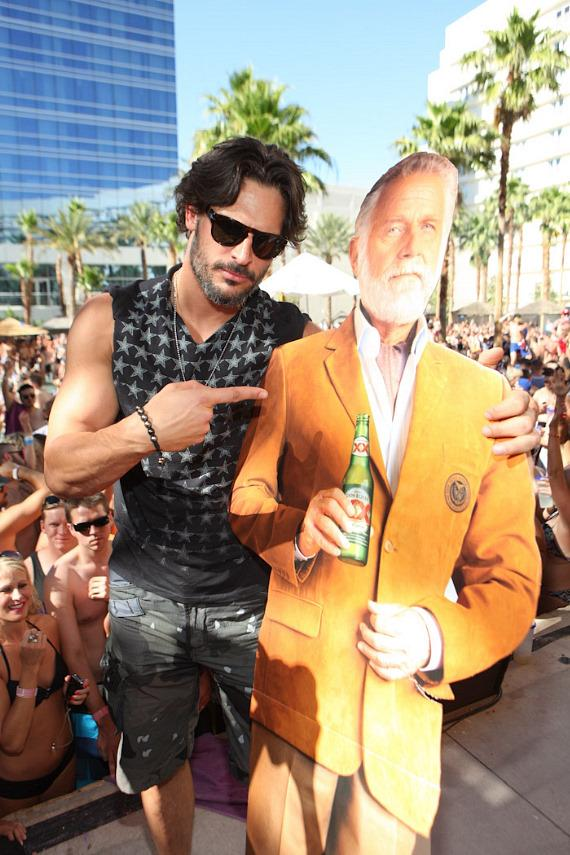 Joe Manganiello with poster of Dos Equis spokesman Jonathan Goldsmith