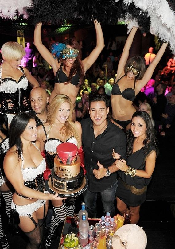 Mario Lopez and Courtney Mazza at Gallery nightclub with the dancers from Pussycat Dolls Burlesque Saloon