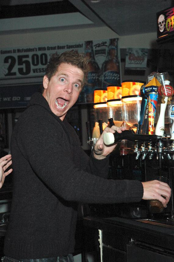 Mark Long pouring beer at McFadden's