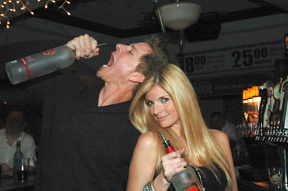 Mark Long and Trishelle Cannatella having fun with bottles of liquor at McFadden's Restaurant and Saloon