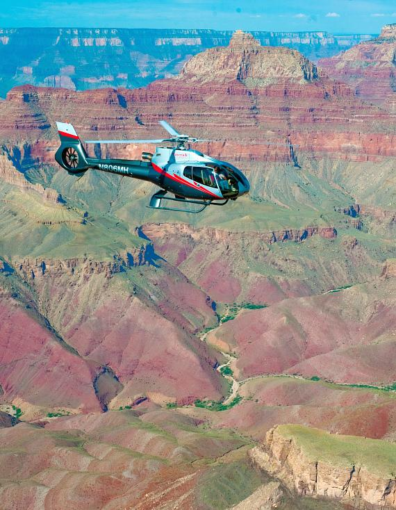 Maverick Helicopters flying at the South Rim of Grand Canyon