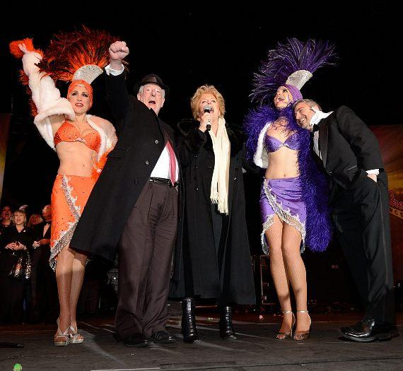 Mayor Carolyn G. Goodman and former mayor Oscar Goodman with Vegas Showgirls