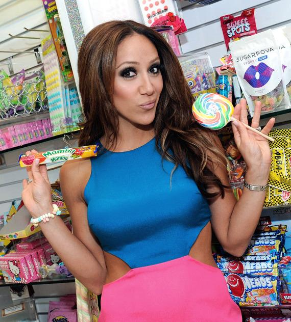 Melissa Gorga with various sweet treats inside Sugar Factory