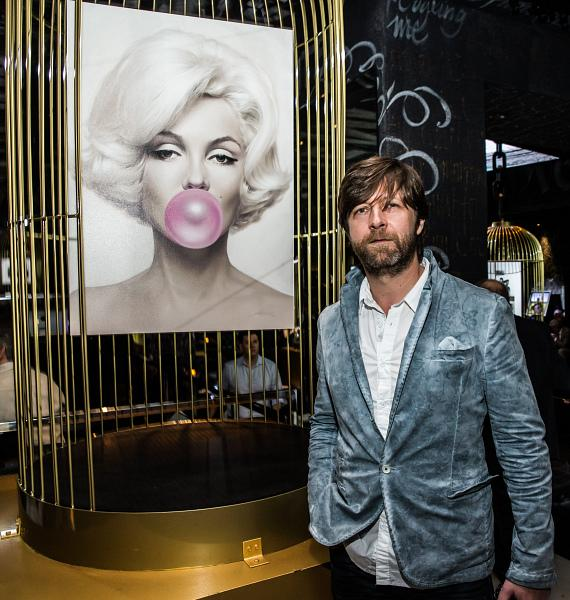 Michael Moebius with his painting of Marilyn Monroe at the Iconic Images Gallery after-party inside Foxtail