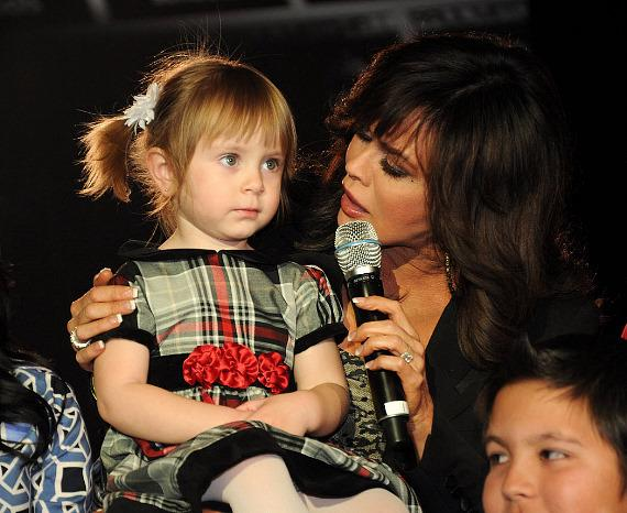 Marie Osmond with child in audience