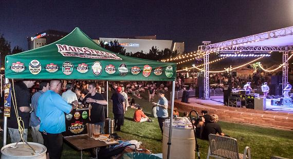 Festival goers enjoying the 2013 Downtown Brew Festival's live entertainment and diverse craft beer offerings inside the Clark County Amphitheatre