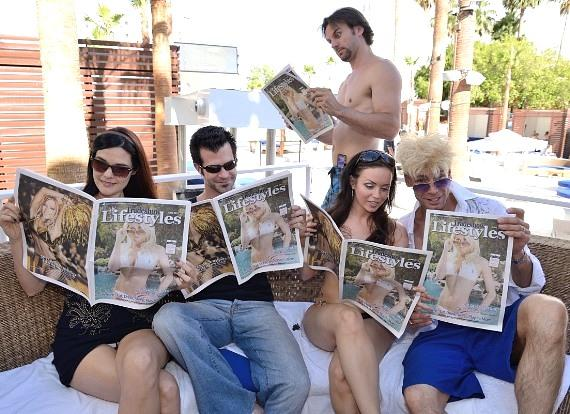 Murray and friends read Lifestyles Magazine issue with Chloe on the cover