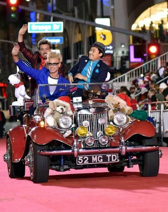Murray SawChuck rides in a parade car in during the Hollywood Christmas Parade