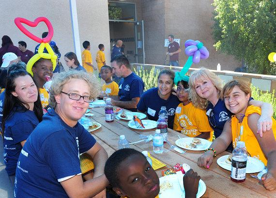 The kids enjoy a BBQ lunch prepared by the Boys & Girls Clubs board members